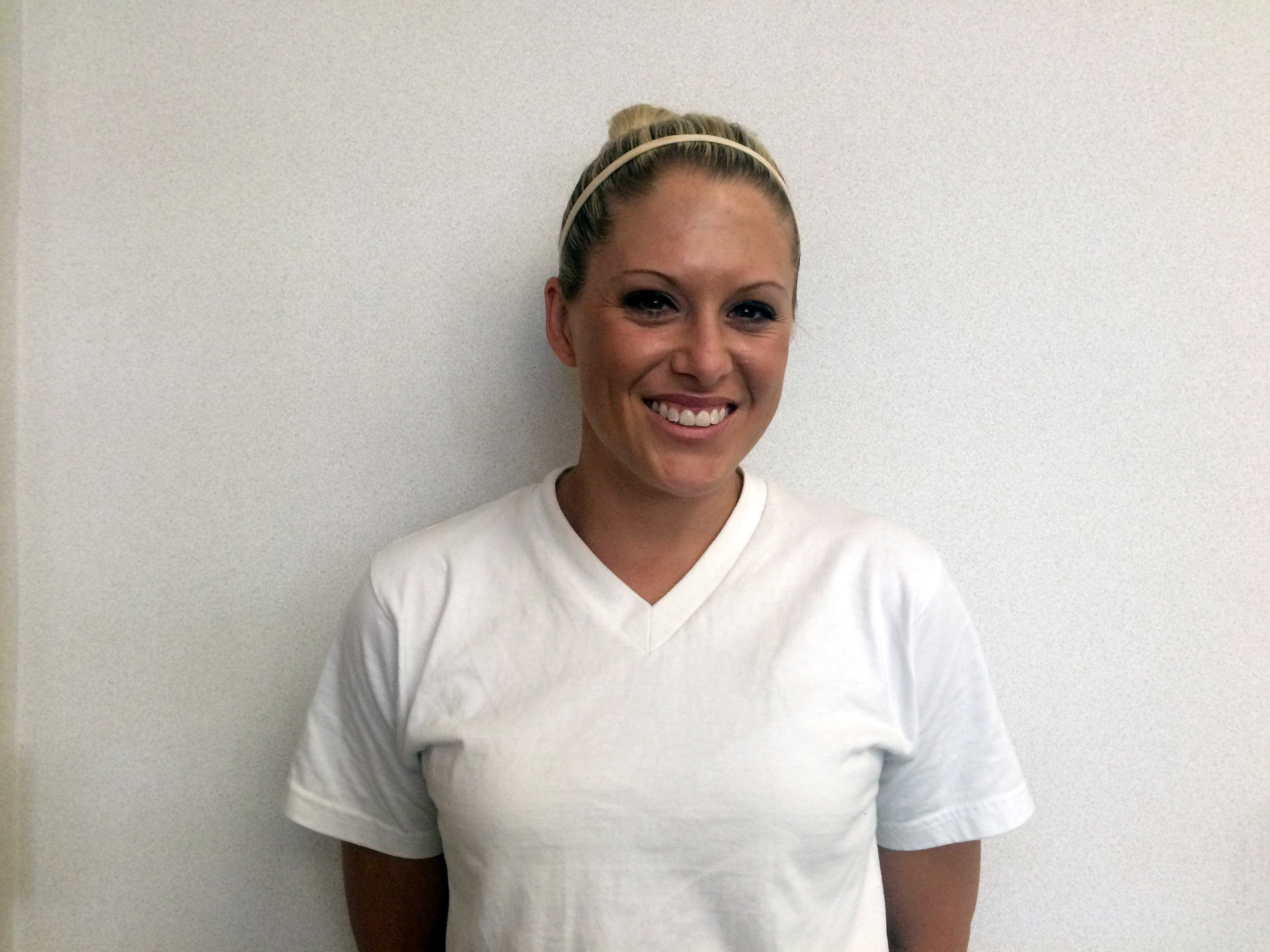 Dance and physical education teacher Tara Bearden smiles eagerly for her new students.