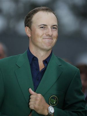 2015 Masters winner Jordan Spieth celebrates by wearing the famed green jacket, given to each year's champion.