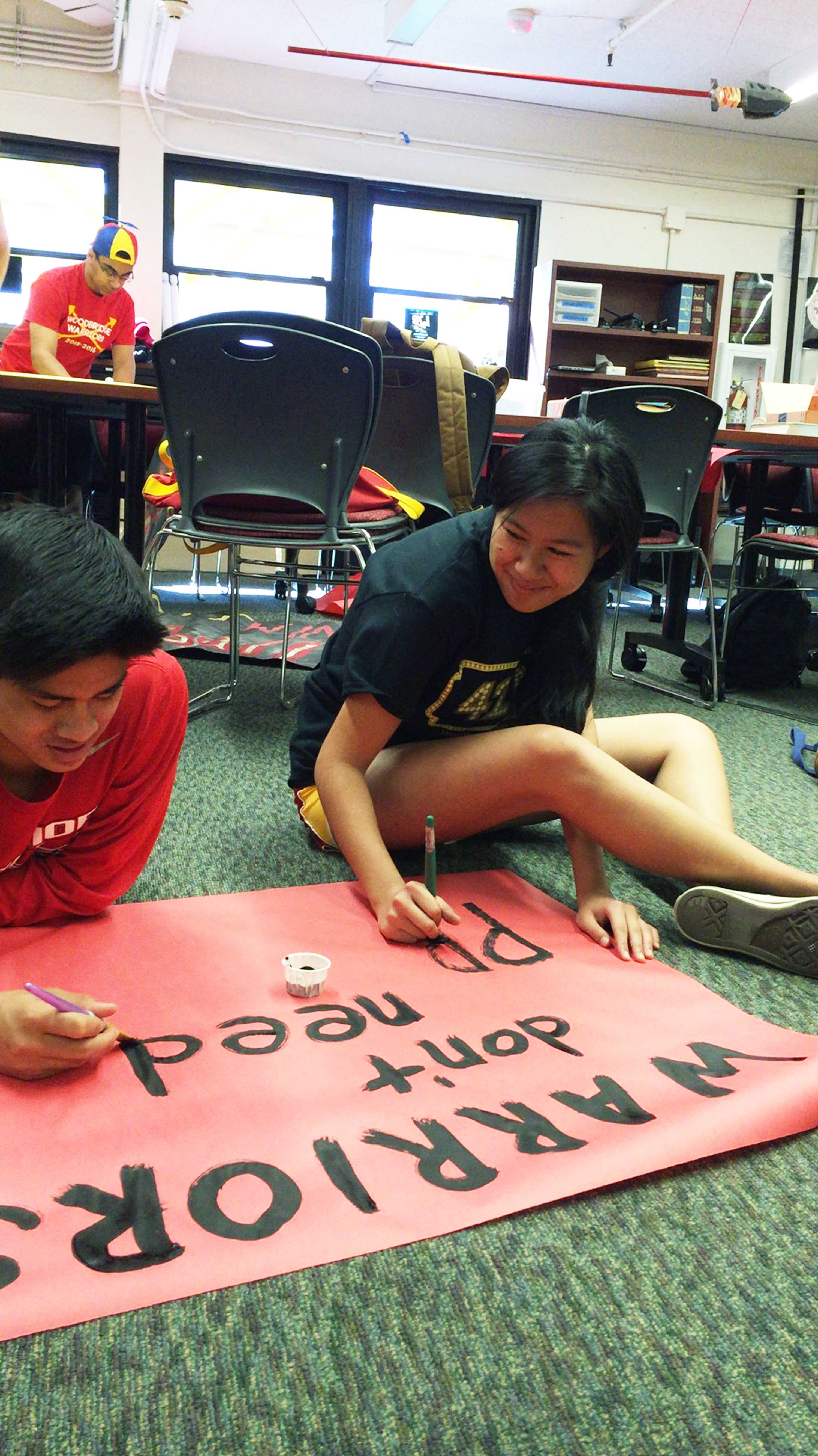 Samantha Kosai helps make poster to awaken warrior spirit for students around campus