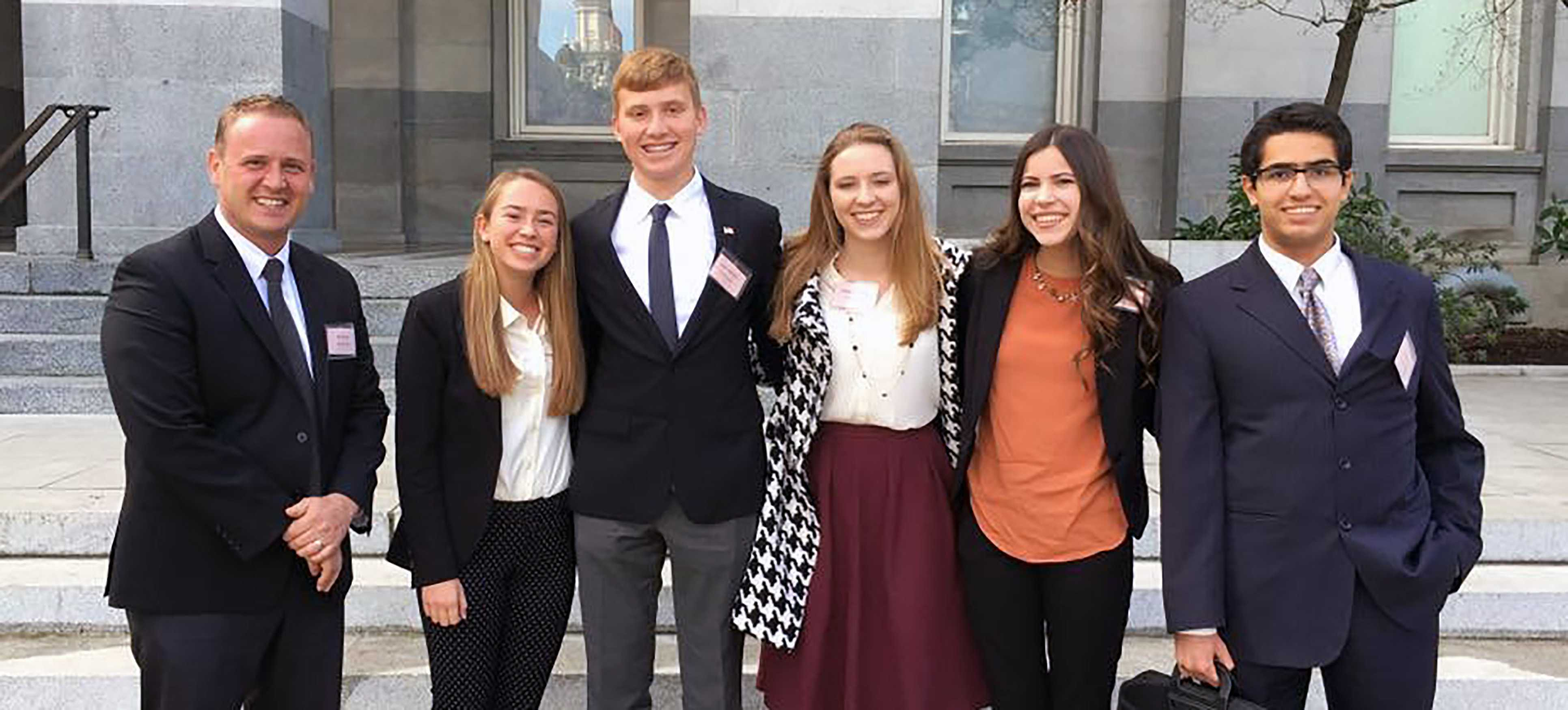 Principal Christopher Krebs, juniors Elizabeth Dahl, Justin Weiner, Mikayla Knutson, Logan Prock and senior Ali Karimi prepare to give their proposals in Sacramento.