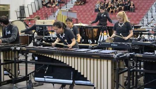 Senior Synie So performs onstage with percussion at the World Competition in Dayton, Ohio.