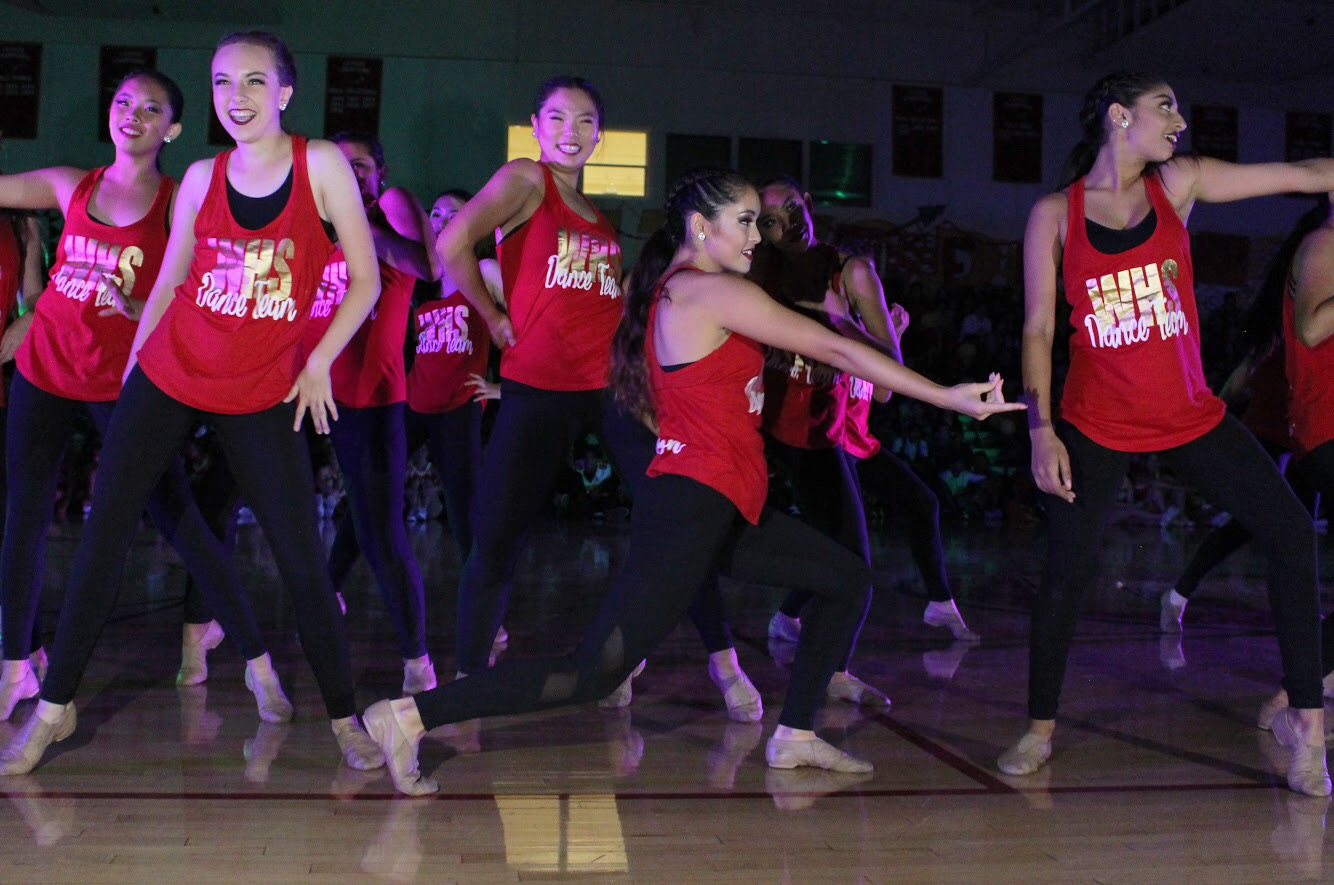 Dance team performs a routine that incorporates multiple styles of dance during the fall pep rally.