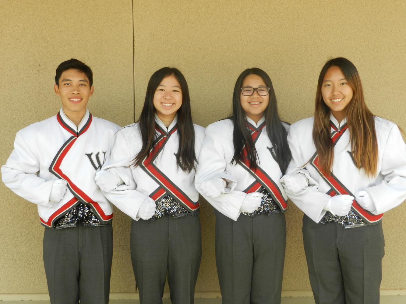 Senior drum majors (left to right) Malcolm Tsay, Jody Lin, Sabrina Wang, and Margaret Lee pose in  in their distinct drum major uniforms.