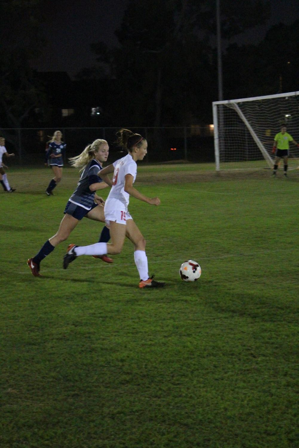 Sophomore Hannah Cooper gains control of the ball and runs towards the goal.