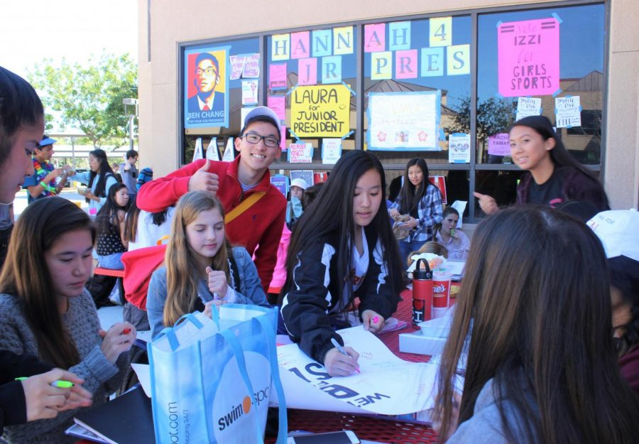 ASB+President+candidate+Benjamin+Chang+poses+with+potential+voters+during+lunch.%0A