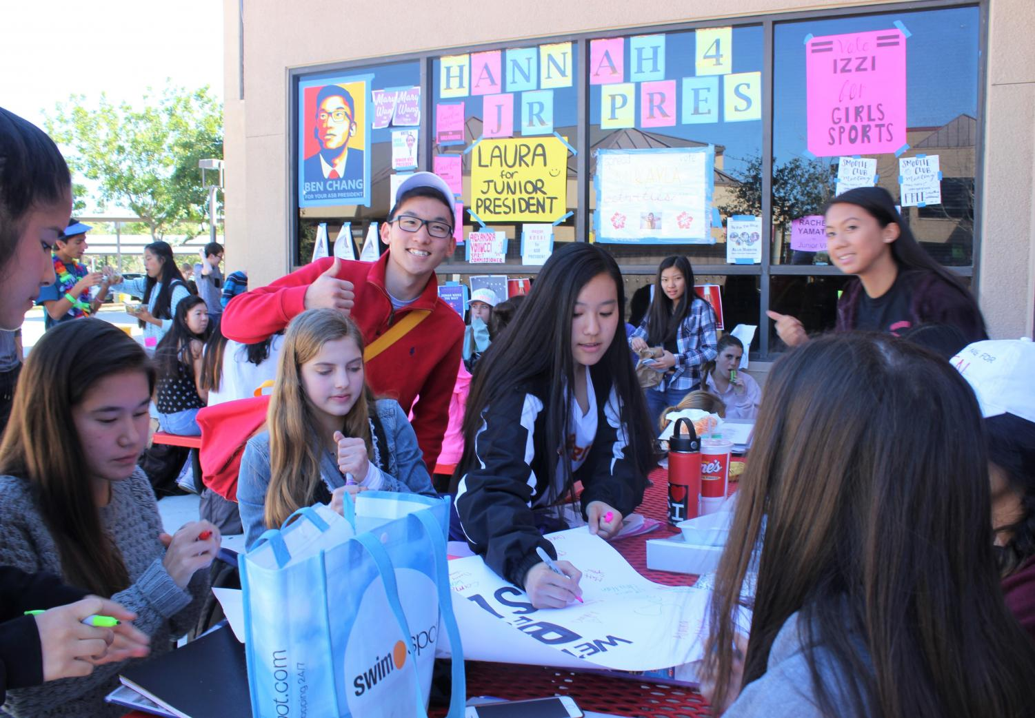 ASB President candidate Benjamin Chang poses with potential voters during lunch.