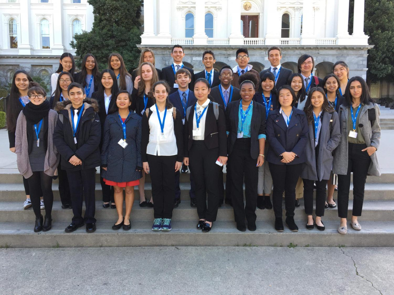 Students from the Irvine Unified School District gather together in front of the Capitol Building in Sacramento to discuss legislative impact on education.