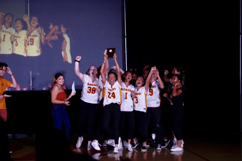 The Woodbridge Girls Lacrosse team celebrates their victory at Air Guitar.