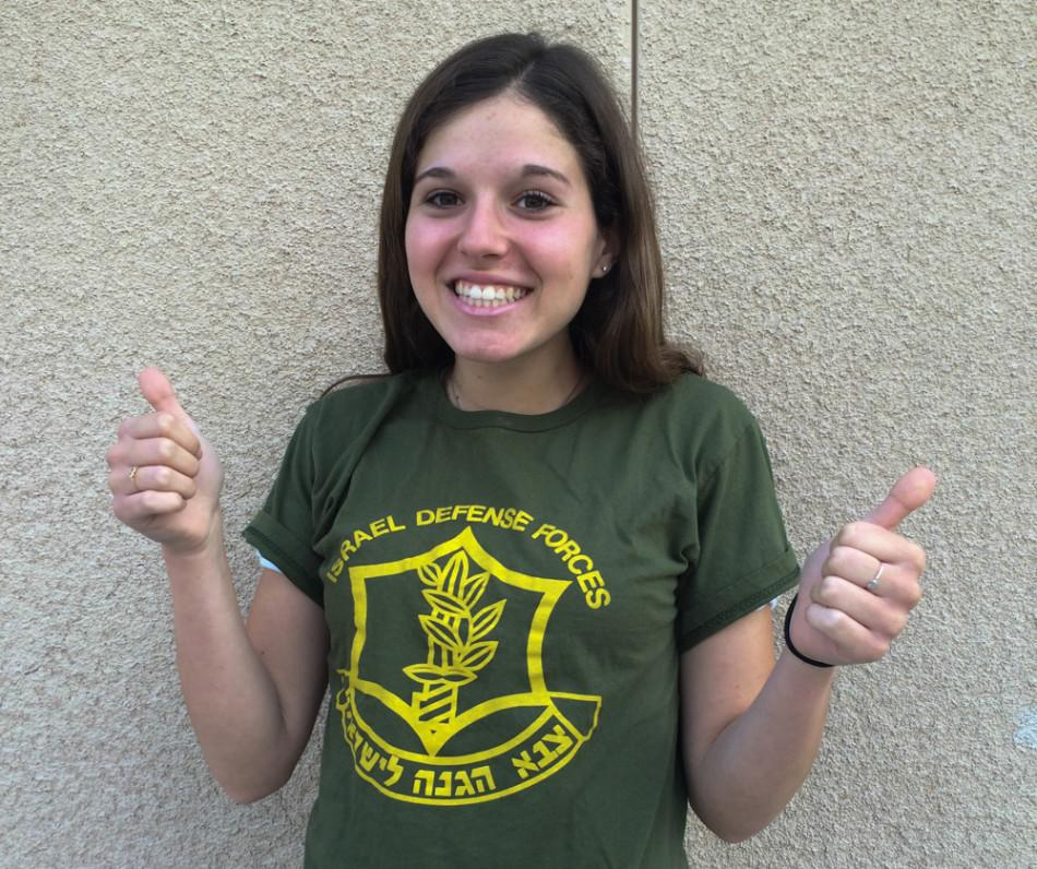Sharon Solel proudly shows off her Israel Defense Force t-shirt.