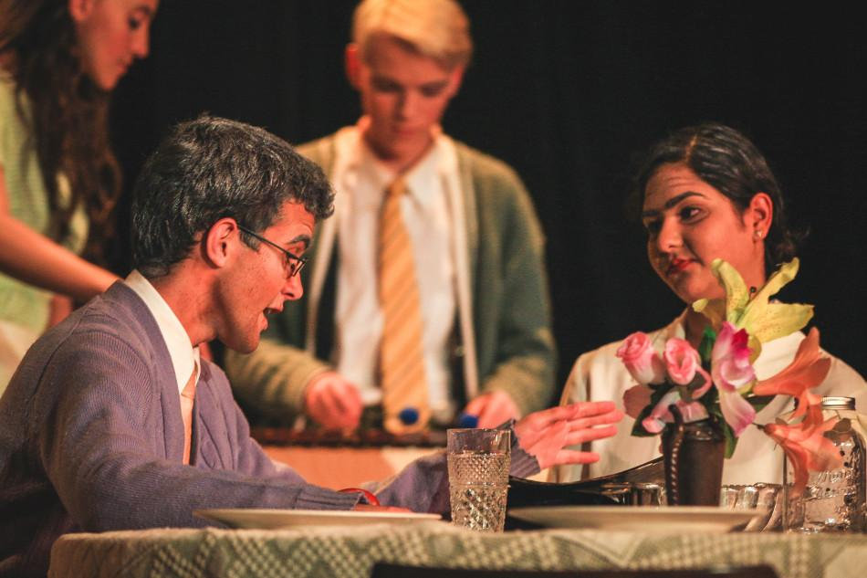 Seniors Cole Webb Harter (left) and Saumya Gupta (right) portray their characters in a scene on stage during the fall play.