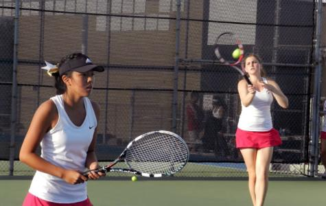 Senior Karina Yamasaki (Left) and Nicole Dostanic (Right) anticipate a rebound hit to the opposing team.