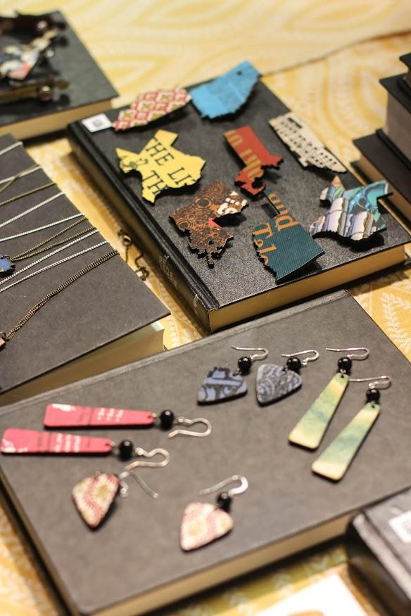 Yes & Yes Designs displays jewelry made from books at the Holiday Market.