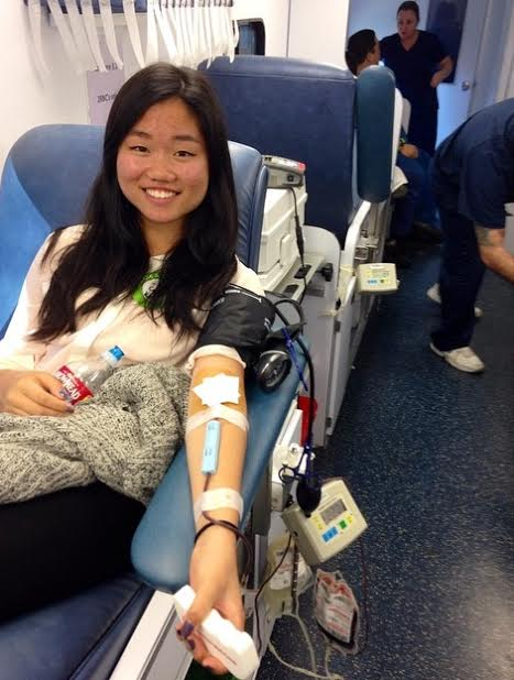Senior Caryn Wong donates blood for the first time, eager to recieve ice cream afterwards.