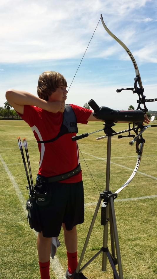Freshman+Jack+Williams+draws+back+his+bow+and+prepares+to+fire+at+a+target+at+an+archery+range.+