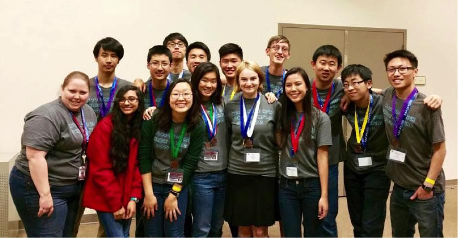 The Science Olympiad team smiles triumphantly after placing fifth in the regional competition.