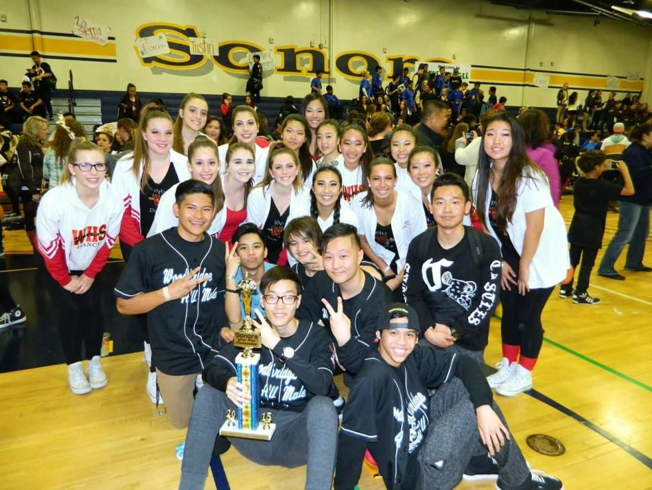 Members of the dance team proudly show the 2nd place award won by the all male group.