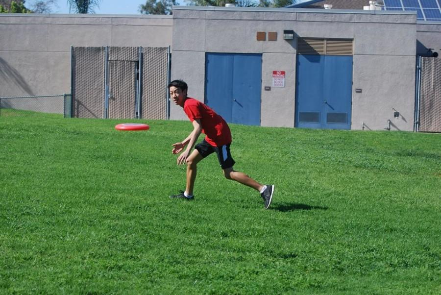 Junior James Nguyen lines up to snatch a frisbee from the air.