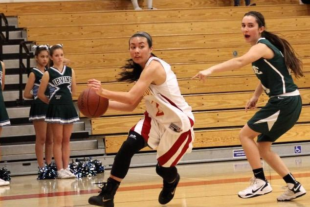 Junior+Alissa+Niewiadomski+rushes+down+the+court+during+a+recent+game.+