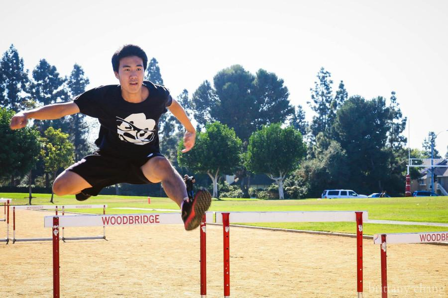 Junior Daniel Sun practices hurdles during an on-campus preseason track practice.