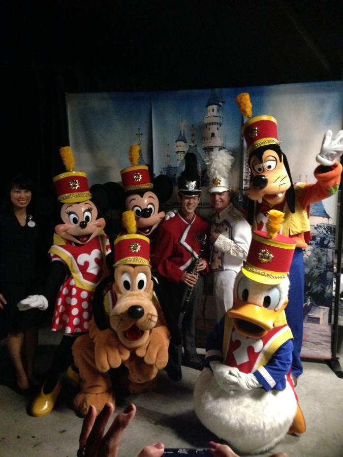 Drum major and senior Scott Numamoto posing with the Disneyland Band drum major