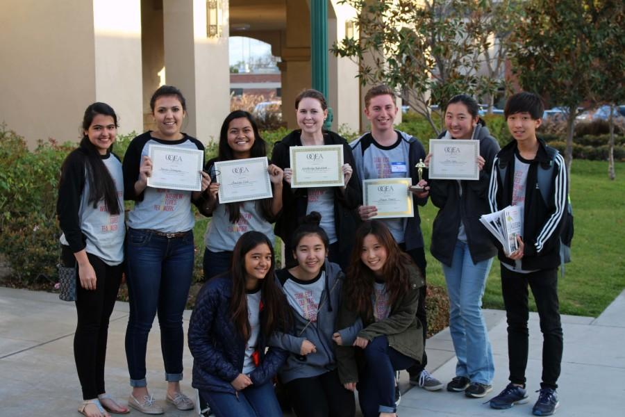 The Golden Arrow Staff and adviser pridefully show off their awards at Fullerton College after the write-offs.