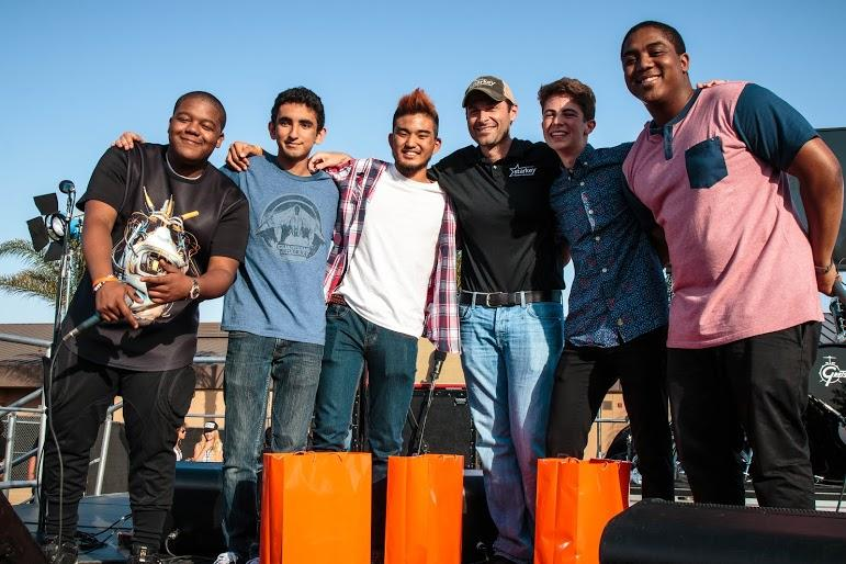 Junior+Dan+Lesser+and+seniors+Ken+Nakama+and+Josh+Maslaki+pose+with+the+Massey+brothers%2C+Chris+and+Kyle.