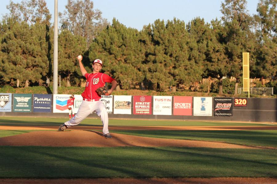 Junior Alex Kent thrusts himself forwards and prepares to throw a pitch.