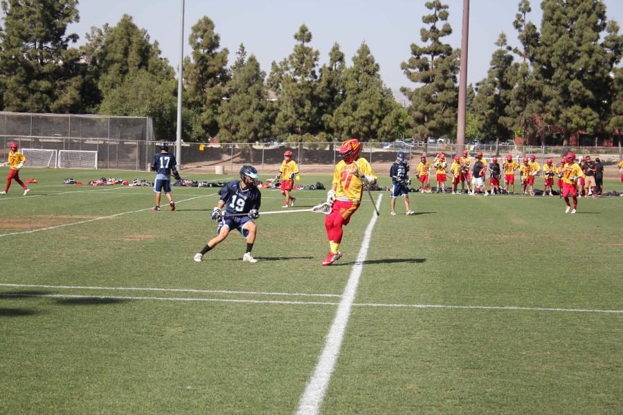 Senior Zach Kennedy jumps back to defend an assault from a Trojan player.
