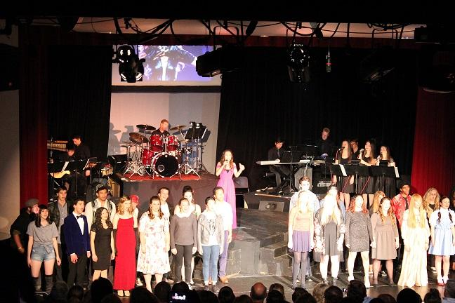 Vocal students take a bow at the end of their successful performances, still dressed as the musical legends that they impersonated.