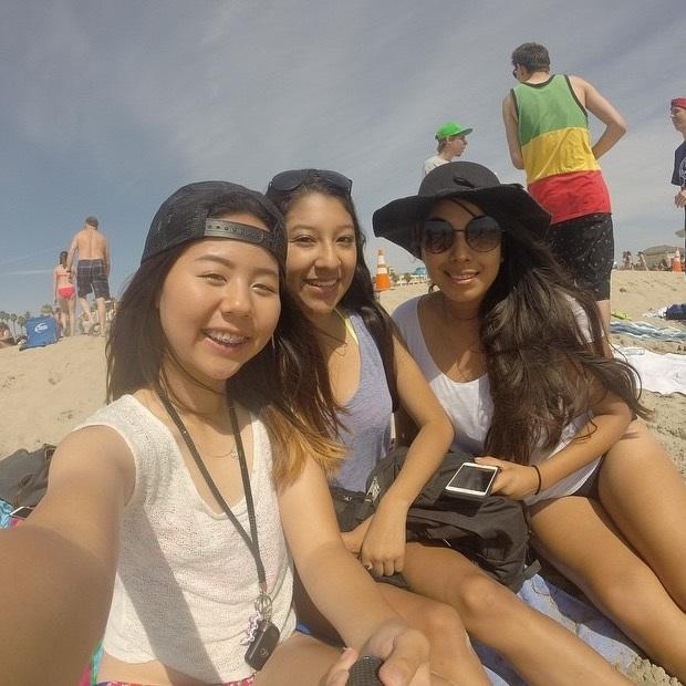 Junior Jin Kim takes a selfie with friends on the beach.
