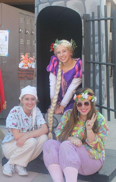 Seniors+Anna+Bellingham%2C+%28left%29%2C+Becca+McHenry+%28center%29+and+junior+Jenna+Rosebrough+%28right%29+attend+the+carnival.+