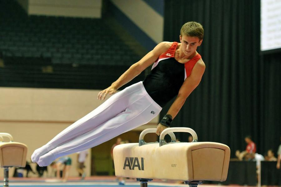 Senior Casey Branin performs his routine to the judges at his gymnastic competition