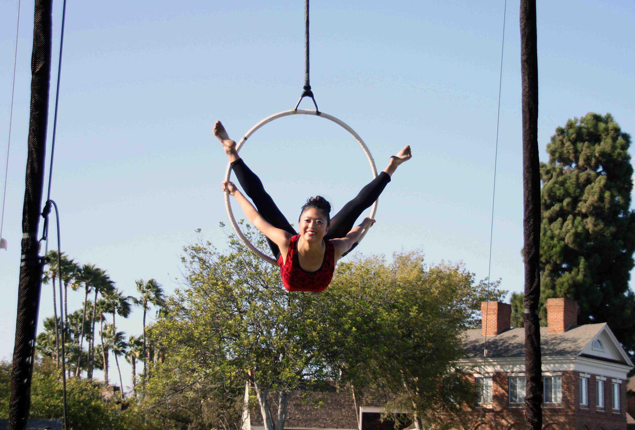 Senior Yoshida hangs above the trees during her performance