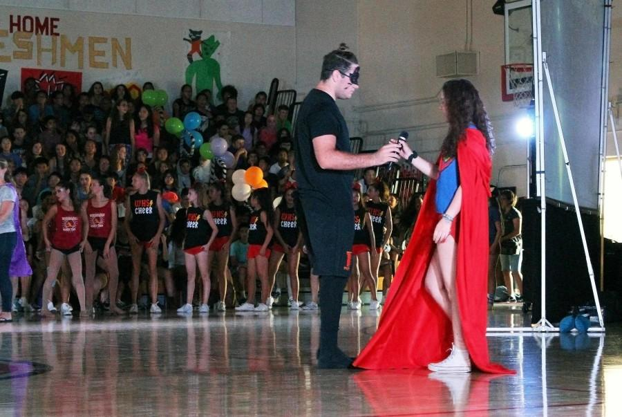 The Pep Rally host hands the mic to the singer for the Alma Mater