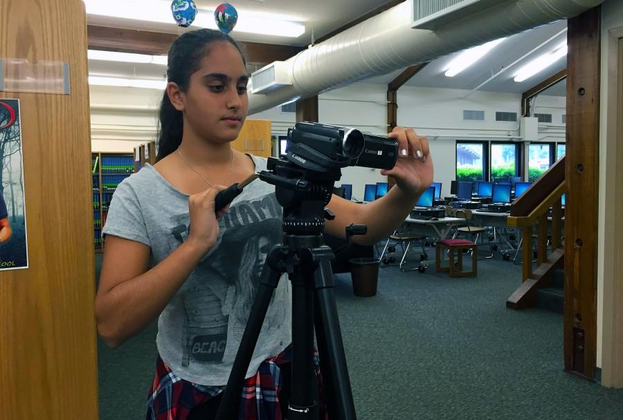 Farida Korany displays her passion for digital media as she takes a video.