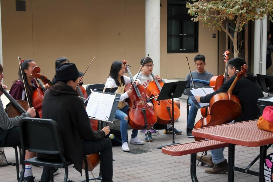 Orchestra students of the Grammy-nominated music program rehearse in the music quad.