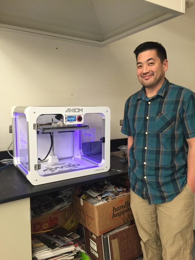 Art teacher Matthew Takeno proudly displays the new 3D printer.