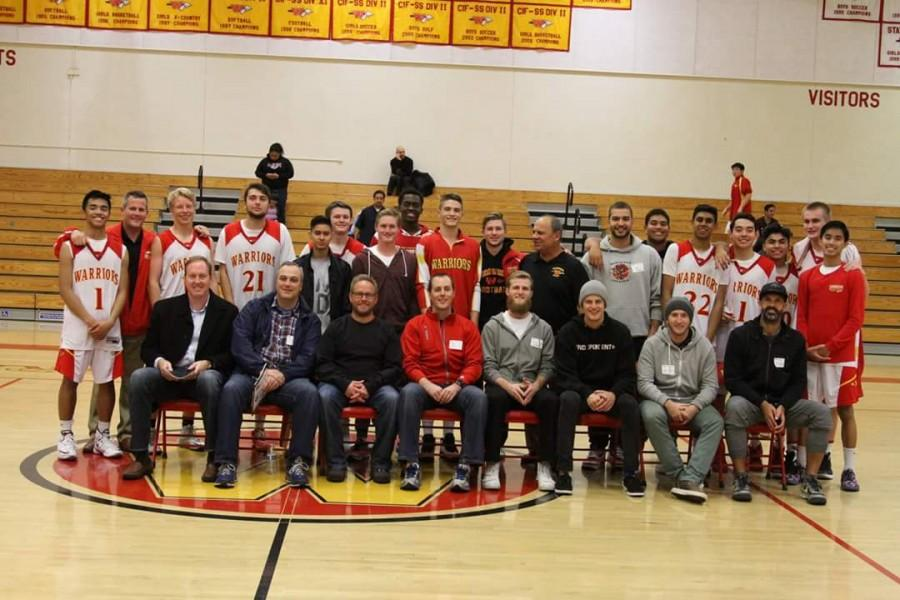 Past alumni join the boys varsity basketball team after a successful season.