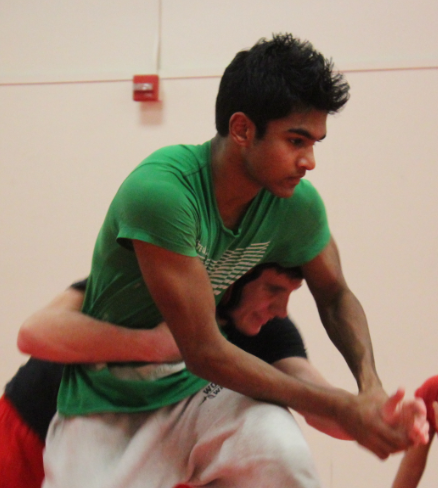 Junior captains Neil Naraj and Liam MacArthur demonstrate a body lock to their teammates in order to prepare for upcoming matches against Northwood High and Beckman High.