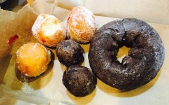 Dunkin Donuts provides an assortment of donuts and Munchkins, including chocolate glazed and strawberry jelly filled.