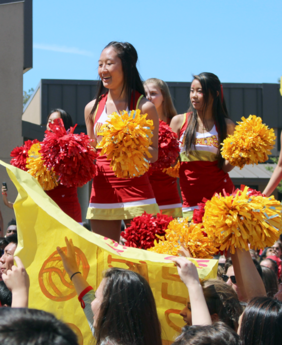 Cheerleaders and students chant and show school spirit at the finishing point of the lip dub