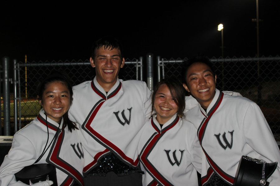 Drum majors junior Jody Lin and seniors Tyler Ravelli, Karen Smith and Noah Pacis lead the performances of marching band during the football games.