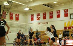 Volleyball faces an unsuccessful side-out against the Patriots