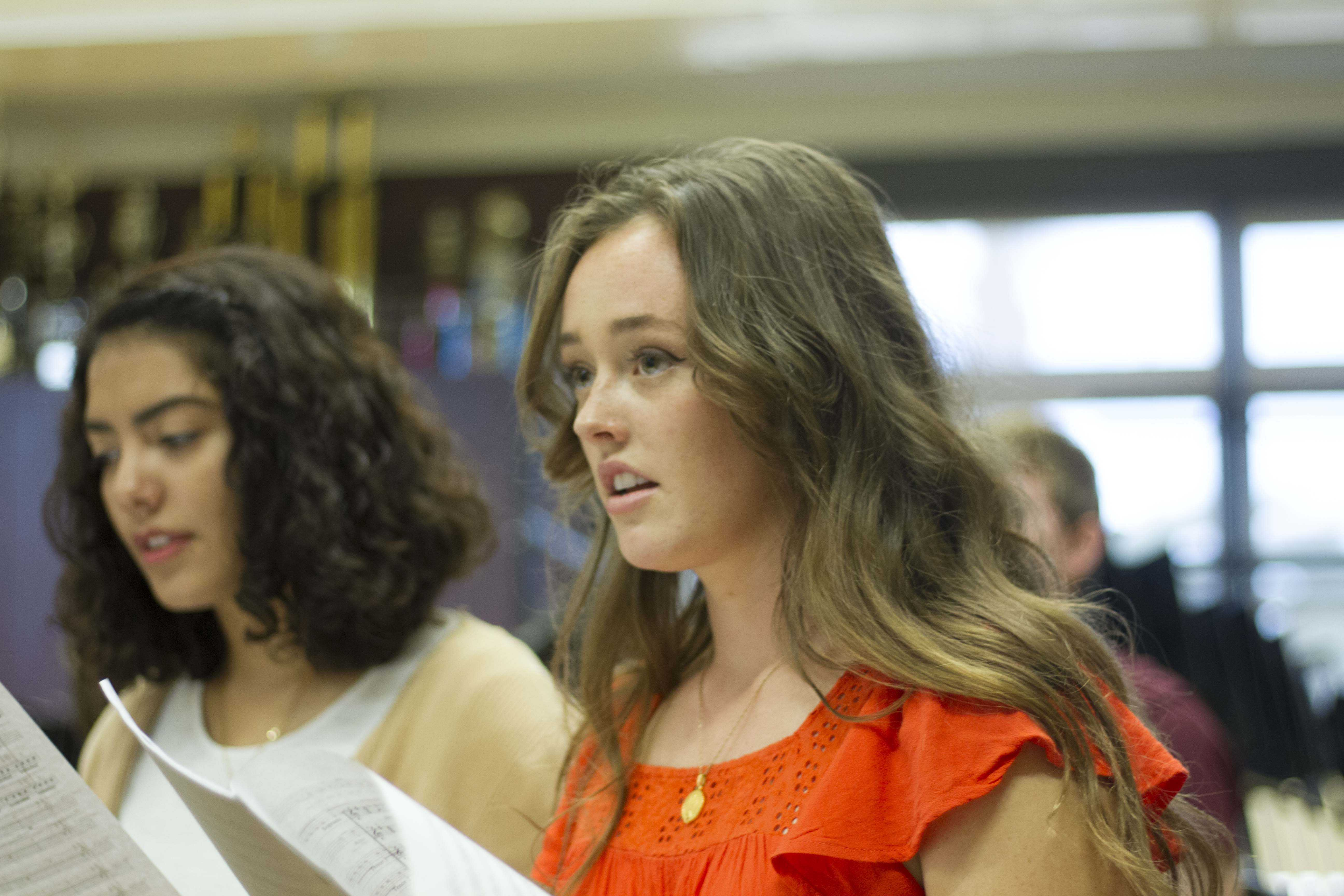 Allie Hunter (pictured right) sings with her alto section during an Entertainers rehearsal.
