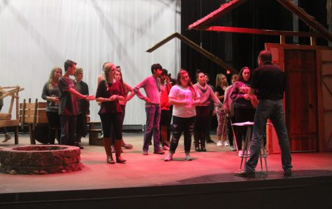 Cast members rehearse for their upcoming  performance.