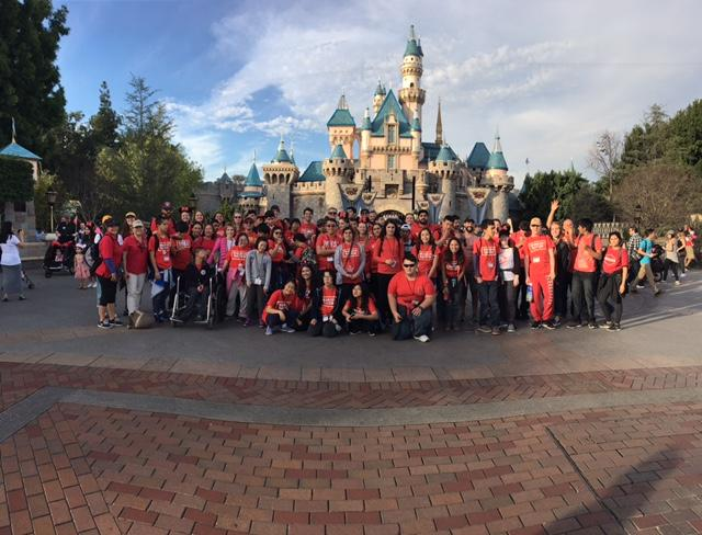 Warrior Nation gathers for a photo in front of the Disneyland Park castle for their annual trip to the park.