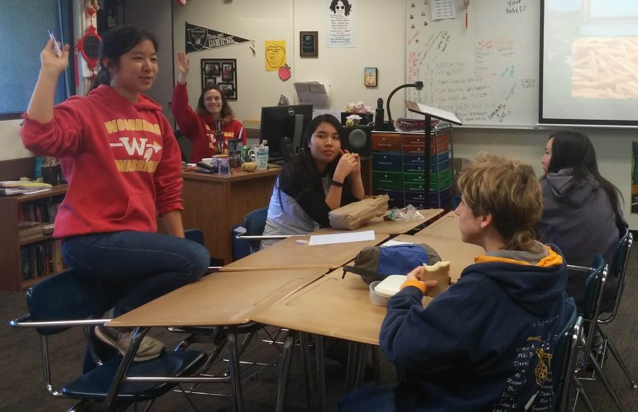 Junior Jody Lin leads the students into creative activities to improve their writing skills.