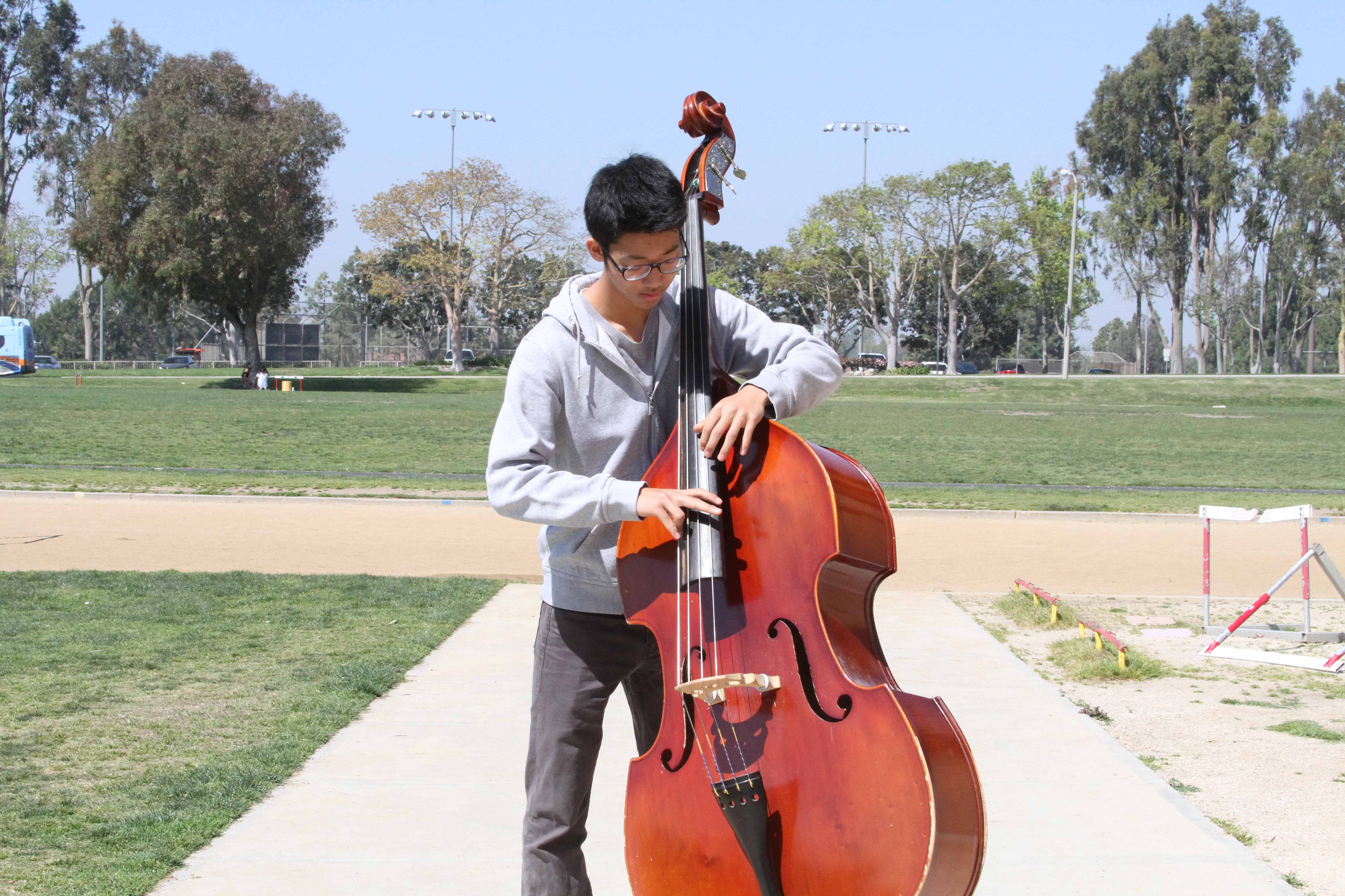 Sophomore Alphonse Oh dedicates long hours into mastering his skills on the bass and performance ability.