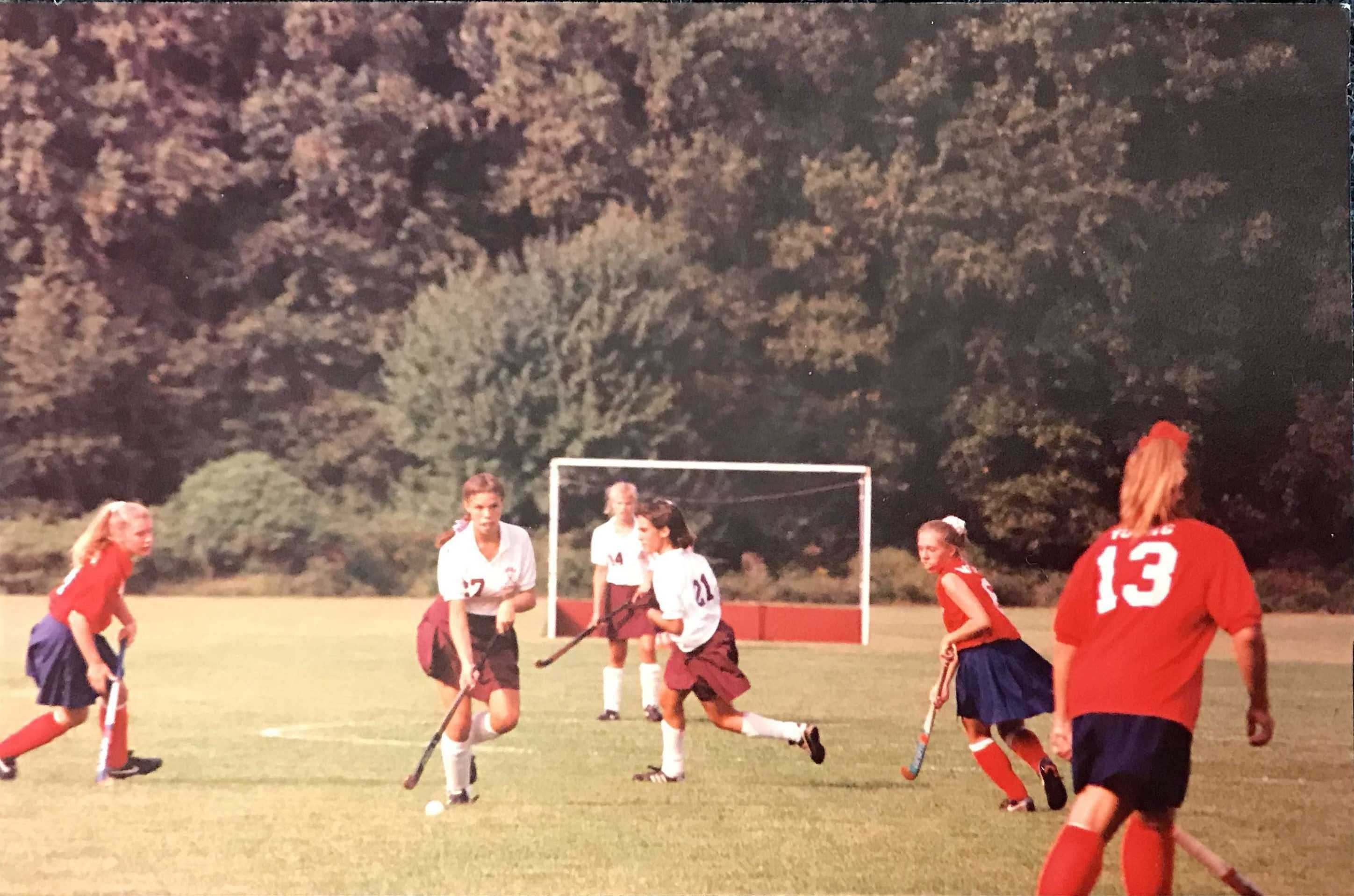 Laura Mattair (right-center)  looks back on the days of field-hockey as a high school student-athlete.