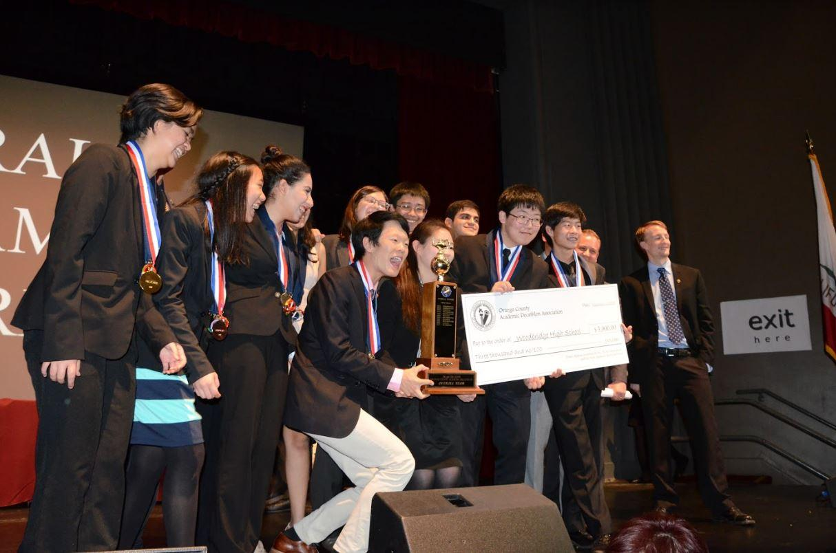 Academic Decathlon members express their jo and excitement in receiving a $3,000 scholarship for the school and having numerous members winning scholarships themselves.